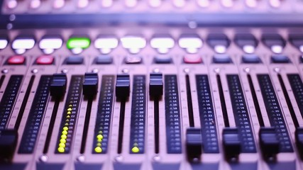 Cool shot of Digital Audio Console Faders and Sled Screen