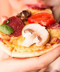 Woman eats tasty italian pizza