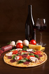 Tasty italian pizza and red wine