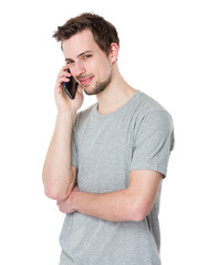 Studio shot of a young handsome man at the phone