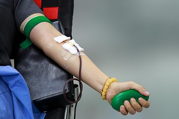 Left hand blood donation with rubber hand grip