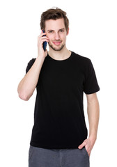 Portrait of happy young man talking on cell phone isolated on wh