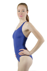Sport girl in a blue bathing suit on a white background