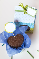 Chocolates hearts with present boxs in a white background