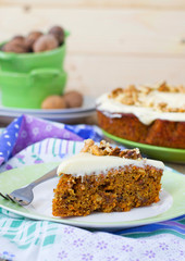 carrot cake with walnuts and cream