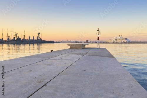 Aluminium Athene Harbour light and ships in Faliro, Athens, Greece.
