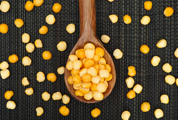 Split yellow peas in a wooden spoon
