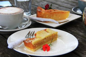 Cup of cappuccino and a slice of cake