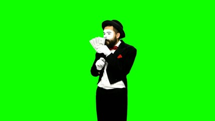 Funny man mime counts money and hides it on green screen