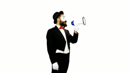 Funny man mime uses speaker on white background
