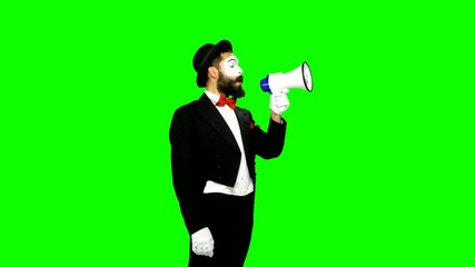 Funny man mime uses speaker on green screen
