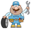 Smiling Mechanic Cartoon Character With Tire And Huge Wrench