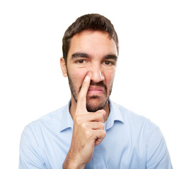 Close up of a young man with gesture of bad smell