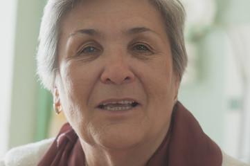 Senior women face smiling closeup toned image