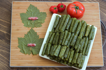 Grape leaves stuffed with meat and rice before cooking.