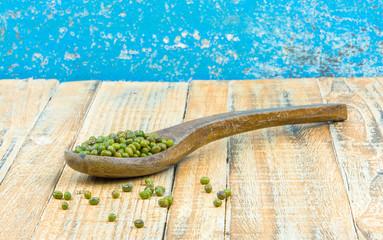 bean in wooden spoon