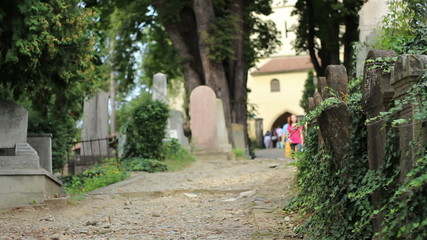 People Walking in Old Cemetery