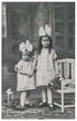 Old photo of little girls with flowers. Vintage picture