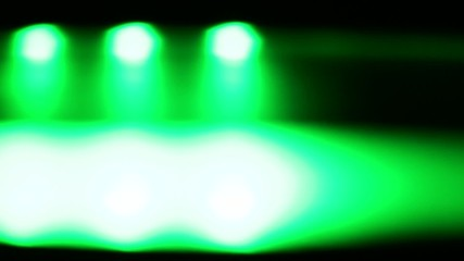 Horizontally moving green LED light at night