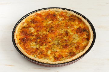 Round cheese tart on white background
