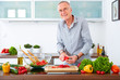 Mature man in the kitchen prepare salad X