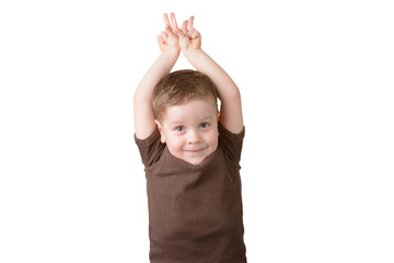 little boy with hands raised