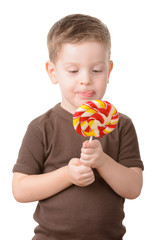 little boy licked with candy on a stick