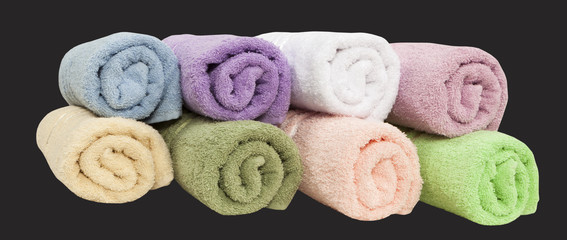 set of twisted towels isolated on black background
