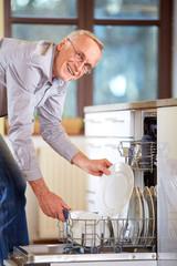 Senior man empty out the dishwasher
