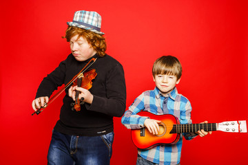 Two funny red-hair brothers playing music