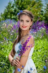 beautiful  happy female  in the wildflowers
