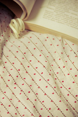 romantic background with book and fabric