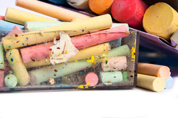 colourful chalks in a box on a white background