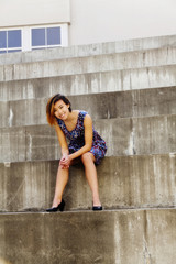 Smiling Attractive Asian American Woman Sitting On Steps