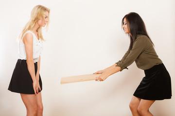 Women friends having fun blowing wind