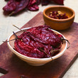 Постер, плакат: Bowl of dried slightly hot red aji chili pepper