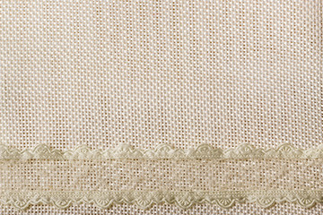 Lace ribbon on sack cloth background