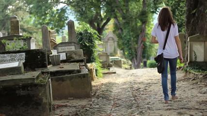 Two Girls Walking in Cemetery