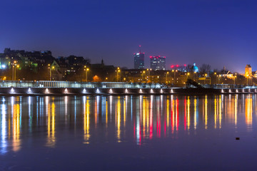 Panorama of Warsaw at night with reflection in Vistula river