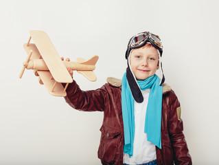 Smiling child (kid, boy) in helmet