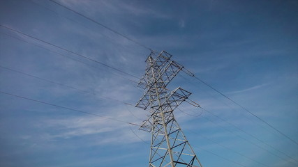 Electricity towers on a background of blue sky timelapse