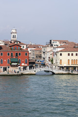 Quay and pedestrian bridge over channel in Venice