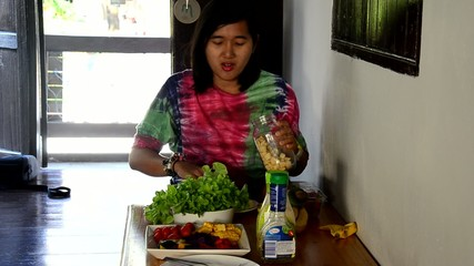 Woman cooking vegetable and fruit Salad.