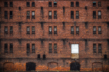 wall of the old factory building of red brick