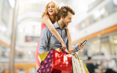 Delighted couple on the shopping