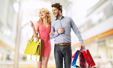 Joyful marriage couple in the shopping mall