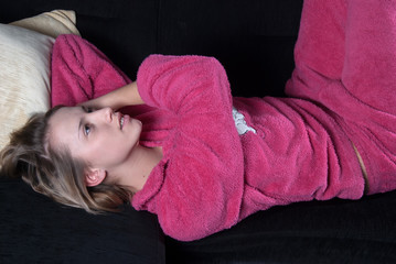 Teen with pajamas on the couch