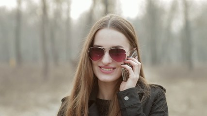 Young beautiful fashionable woman answer a phone call