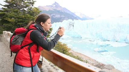 Tourist taking picture of Perito Moreno Glacier