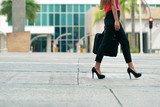 Fototapety Business woman commuting going to office by walk